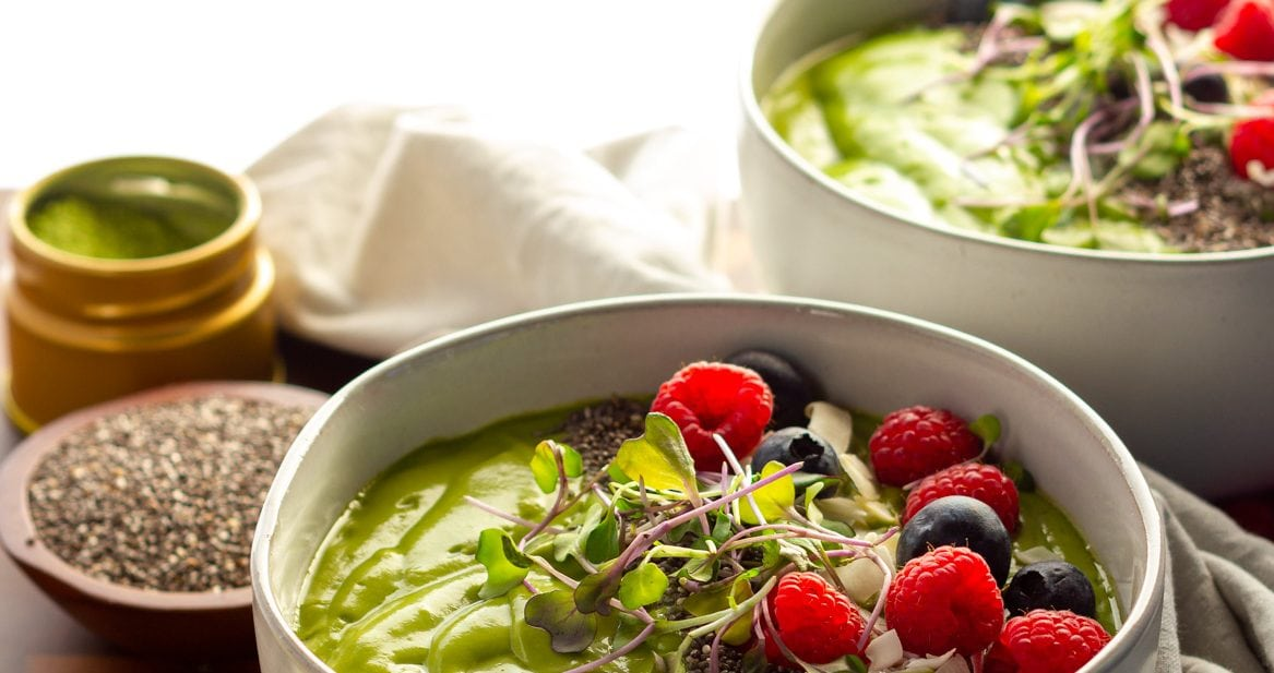 Two Smoothie bowls with fresh berries and chia seeds
