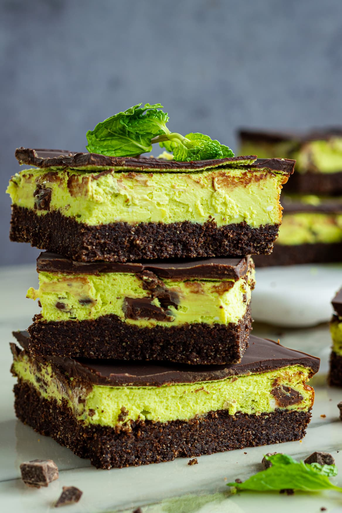 Keto Mint chocolate cheesecake bars with chocolate chunks and a dark chocolate shell.