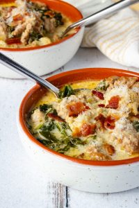 Bowls of keto Zuppa Toscana with bacon and parmesan cheese