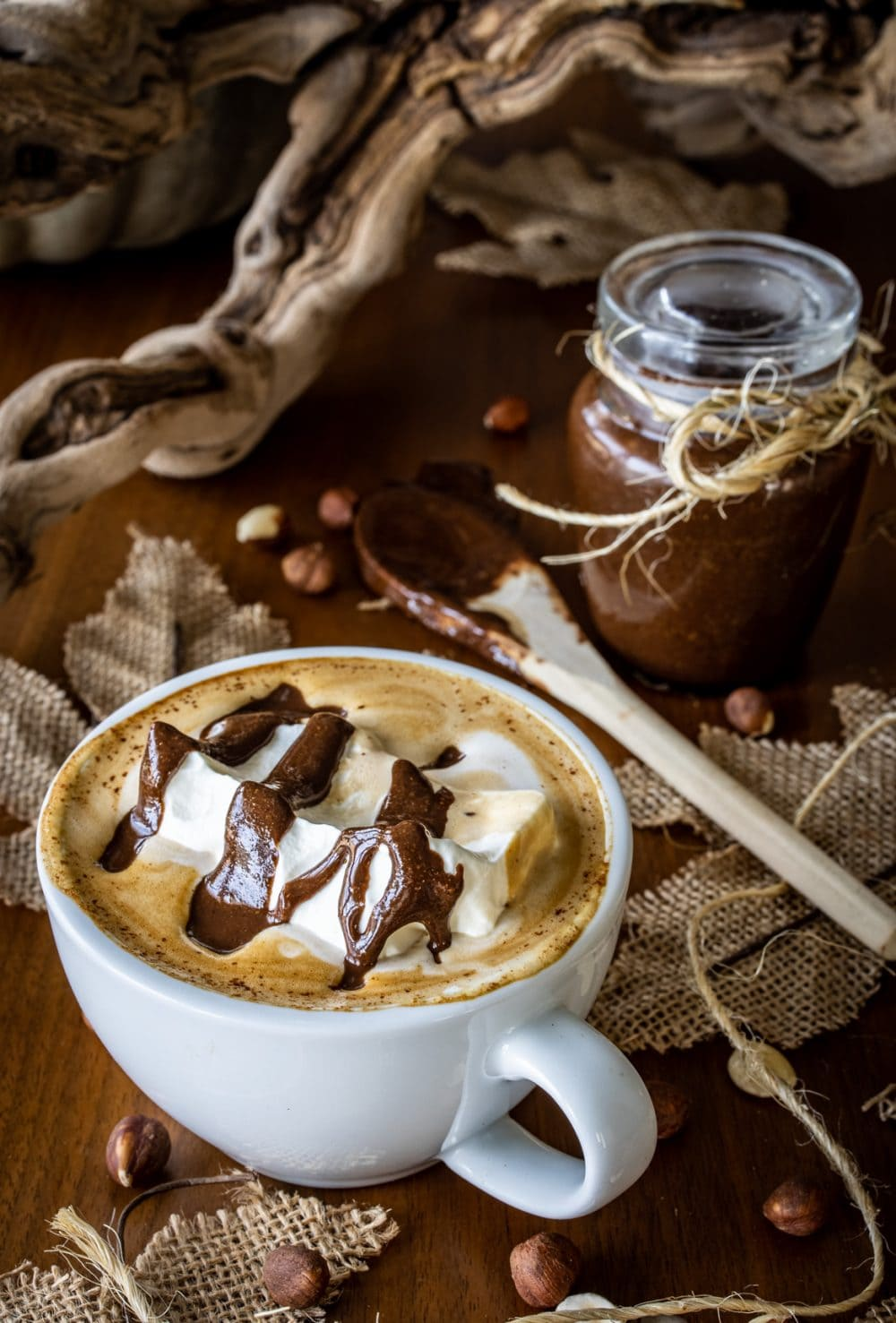 A hazelnut mocha topped with whipped cream and a drizzle of hazelnut butter.
